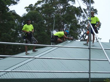Three of our metal roof experts installing a Colorbond roof
