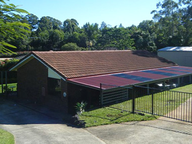New Colorbond verandah roofs and repaired roof tiles after hail damage to roofs